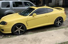 Sell yellow 2005 Hyundai Tiburon manual at mileage 130,000