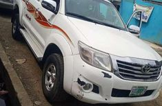 Sell used white 2013 Toyota Hilux automatic at price ₦5,000,000