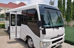 Need to sell cheap used white 2019 Toyota Coaster automatic