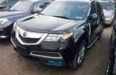 Best priced used black 2011 Acura MDX at mileage 31,250