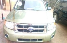 Best priced gold 2008 Ford Escape automatic at mileage 115,000