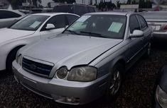 Sparkling cheap used 2004 Kia Optima automatic at mileage 120,000