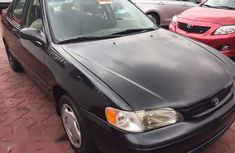 Need to sell high quality 2000 Toyota Corolla sedan automatic at price ₦1,200,000