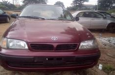 Red 2000 Toyota Carina car automatic at attractive price in Kano