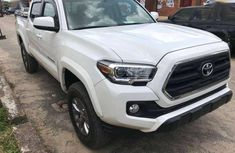 Selling white 2016 Toyota Tacoma at cheap price