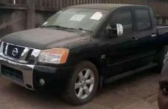 Used black 2004 Nissan Titan pickup at mileage 201,000 for sale