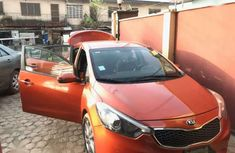 Sell well kept red 2014 Kia Cerato automatic