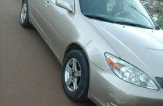 Sharp gold 2003 Toyota Camry sedan automatic for sale