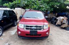 Need to sell red 2011 Ford Escape at mileage 55,000 in Lagos