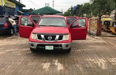 Nissan Frontier 2006 Crew Cab LE Red for sale
