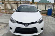 Need to sell white 2015 Toyota Corolla at mileage 32,100