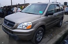 Honda Pilot 2004 EX-L 4x4 (3.5L 6cyl 5A) Gold color for sale