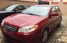Need to sell high quality red 2009 Hyundai Elantra sedan automatic in Lagos