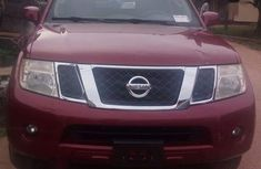 Need to sell red 2011 Nissan Xterra hatchback at price ₦3,200,000