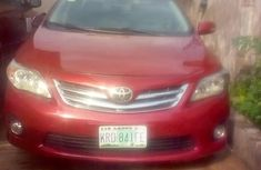 Red 2010 Toyota Corolla car sedan automatic in Ikeja