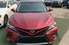 Sell very cheap clean red 2018 Toyota Camry in Lagos