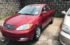 Best priced used red 2003 Toyota Corolla sedan automatic