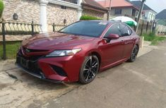 Selling red 2018 Toyota Camry automatic at mileage 0