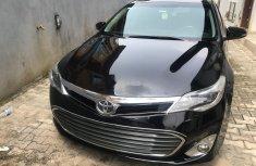 Black 2014 Toyota Avalon car at attractive price in Lagos