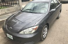Well maintained grey/silver 2004 Toyota Camry automatic for sale in Lagos