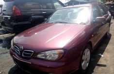 Red 2002 Nissan Primera sedan automatic car at attractive price