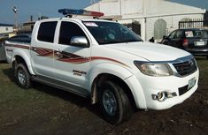 Sell white 2014 Toyota Hilux automatic in Lagos at cheap price