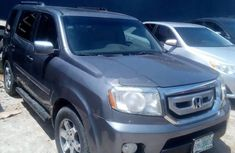 Neatly used grey 2011 Honda Pilot automatic in Lagos