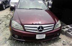 Sell well kept red 2009 Mercedes-Benz C300 automatic