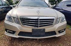 Need to sell high quality gold 2015 Mercedes-Benz E500 at price ₦6,500,000 in Abuja