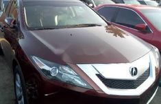 Authentic brown 2010 Acura ZDX automatic in good condition