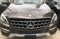 Selling brown 2014 Mercedes-Benz ML350 automatic in good condition in Lagos