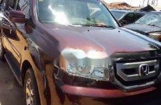 Brown 2009 Honda Pilot at mileage 0 for sale in Lagos