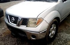 Selling white 2008 Nissan Frontier automatic in good condition in Lagos