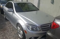 Best priced grey/silver 2010 Mercedes-Benz C350 sedan automatic in Lagos