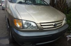 Best priced used gold 2003 Toyota Sienna at mileage 90