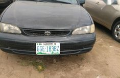 Selling black 2000 Toyota Corolla automatic at mileage 1,000