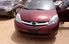 Need to sell cheap used red 2013 Toyota Corolla sedan