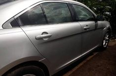 Sell grey/silver 2013 Ford Taurus at mileage 88,319 at cheap price