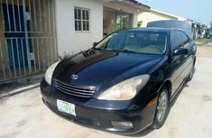 Need to sell black 2003 Chrysler ES sedan at price ₦1,200,000