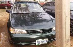 Sell very cheap clean grey 1999 Toyota Corolla in Abuja