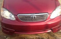 Sell well kept red 2003 Toyota Corolla sedan at price ₦1,850,000