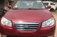 Need to sell red 2008 Hyundai Elantra at mileage 95,000