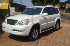 Need to sell cheap used white 2006 Lexus GX at mileage 35,845