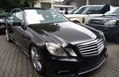 Very sharp neat black 2011 Mercedes-Benz E500 for sale in Lagos
