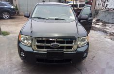 Selling 2008 Ford Escape automatic at mileage 128,000 in Lagos