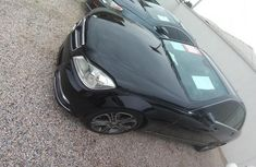 Selling black 2012 Mercedes-Benz C200 automatic in Lagos