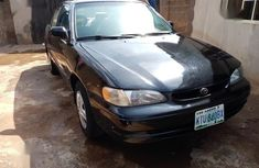 Black 1999 Toyota Corolla sedan automatic for sale at price ₦600,000