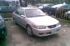 Selling grey 2002 Toyota Corolla sedan in good condition