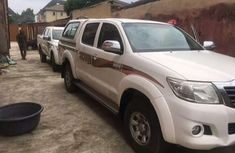 Best priced used white 2015 Toyota Hilux automatic in Lagos