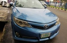 Selling blue 2013 Toyota Camry automatic at price ₦2,600,000 in Ikeja